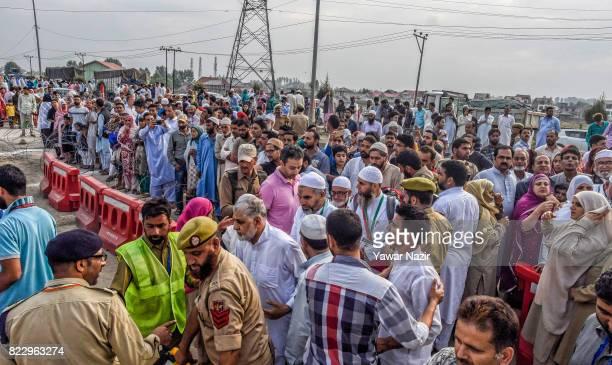 Kashmiri Muslim Hajj pilgrims enter Kashmir Hajj house before departing for the annual Hajj pilgrimage on July 26 2017 in Srinagar the summer capital...