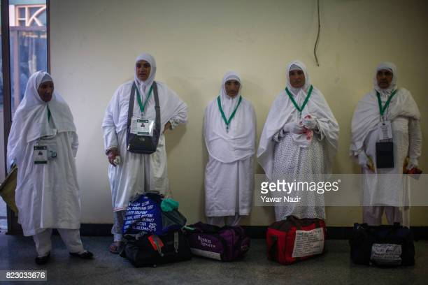 Kashmiri Muslim Hajj pilgrims wait in a Hajj house to board a bus before departing for the annual Hajj pilgrimage to Mecca on July 26 2017 in...