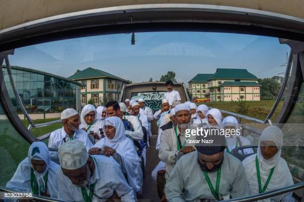 Kashmiri Muslim hajj pilgrims wait on a bus before departing for the annual Hajj pilgrimage to Mecca on July 26 2017 in Srinagar the summer capital...