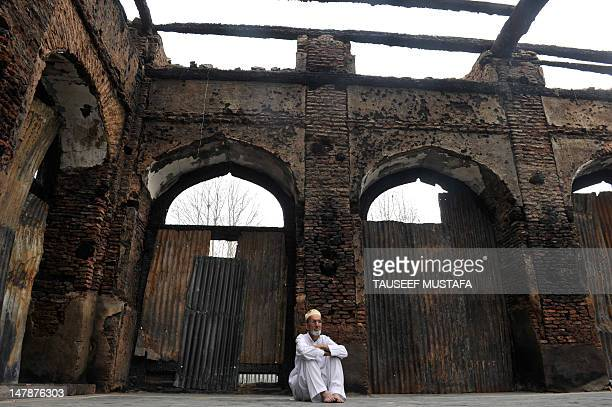 A Kashmiri Muslim man looks at the ruins of a revered 200year old sufi shrine in downtown Srinagar on July 5 which was gutted in a devasted fire...