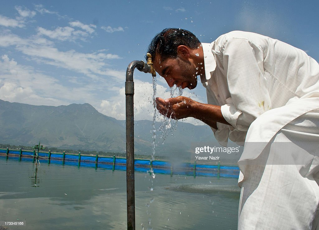 A Kashmiri Muslim man performs ablution before offering prayers on the first Friday of holy month of Ramadan on July 12, 2013 in Srinagar, the summer capital of Indian administered Kashmir, India. Ramadan is the ninth month of Islamic lunar calendar, during which Muslims believe the Quran was given to Prophet Muhammad. Muslims across the globe refrain from eating, drinking and sex from dawn to dusk during the month. Besides spending more time praying, donating alms is mandatory. Every Muslim has to give 2.5 per cent of their wealth and assets, in excess of what is required, to the poor.