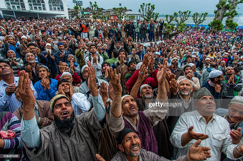 Kashmiri Muslim men pray as a head priest displays the holy relic believed to be the whisker from the beard of the Prophet Mohammed on the occasion of the Muslim festival Mehraj-u-Alam, which marks ascension day, the journey from earth to heavens of the Prophet Mohammed, at the Hazratbal Shrine on May 05, 2016 in Srinagar, the summer capital of Indian administered Kashmir, India. Every year thousands of Muslim devotees from across Kashmir throng the Hazratbal shrine in central Srinagar for prayers and to have a glimpse of the Moi-e-Muqaddas, Holy Relic of Prophet Mohammed, displayed for public viewing on ten occasions in a year , including Meraj-ul Alam , the night Muslims believe Prophet Mohammed ascended to the heaven.