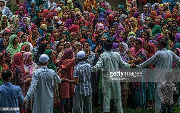 Kashmiri Muslim men stop women from following the funeral procession as the men take the body for the burial of Bilal Ahmad Bhat a civilian who was...