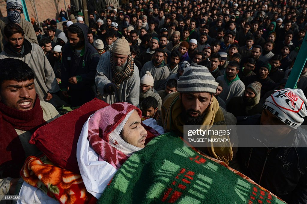Kashmiri Muslim mourners carry the body of Pakistan-based Lashker-e-Toiba militant Tamim during his funeral ceremony in Kulgam district of south Kashmir some 75kms from Srinagar on December 25, 2012, along with Pakistan-based Lashker-e-Toiba militant Mudasir Sheikh alias Mavia a self styled 'district commander'. Security forces confronted the pair of rebels and in the ensuing gunbattle they and a policeman were killed. A police spokesman said that the two were implicated in an attack on The Silver Star Hotel in Srinagar and on an army convoy. AFP PHOTO/Tauseef MUSTAFA