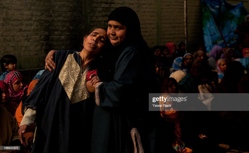 Kashmiri Muslim neighbours and relatives mourn during the funeral of Mushtaq Ahmad Dar, who was killed in a suspected militant attack on November 16, 2012 in Srinagar, the summer capital of Indian administered Kashmir, India. Dar, a 33-year- old salesman, was killed and four others wounded when unidentified gunmen opened fire on a liquor shop in Dalgate area of the city on Thursday evening. Liquor shops have faced attacks from militant groups in the past.
