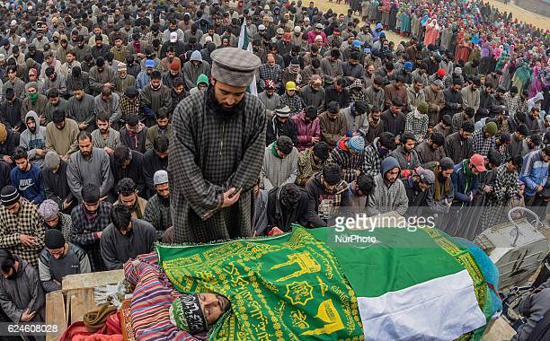 Kashmiri Muslim offer the funeral prayers nest to the body of Rayees Ahmad a militant who was killed in a gun battle with the Indian government...