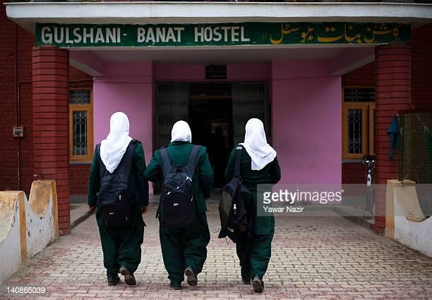 Kashmiri Muslim orphan girls enter the GulshanEBanat orphanage on March 7 2012 in Gopal Pora 16 Km west of Srinagar the summer capital of Indian...