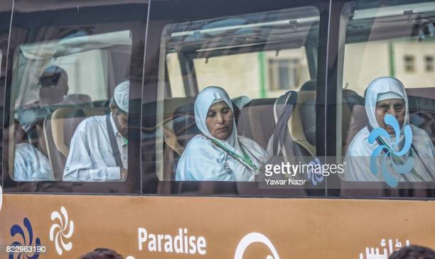 Kashmiri Muslim pilgrim wait in a bus departing for the annual Hajj pilgrimage on July 26 2017 in Srinagar the summer capital of Indian administered...