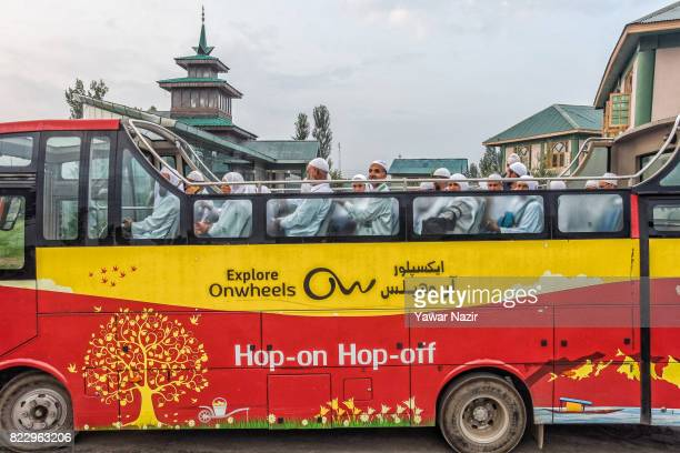 Kashmiri Muslim pilgrims wait in a bus before departing for the annual Hajj pilgrimage on July 26 2017 in Srinagar the summer capital of Indian...