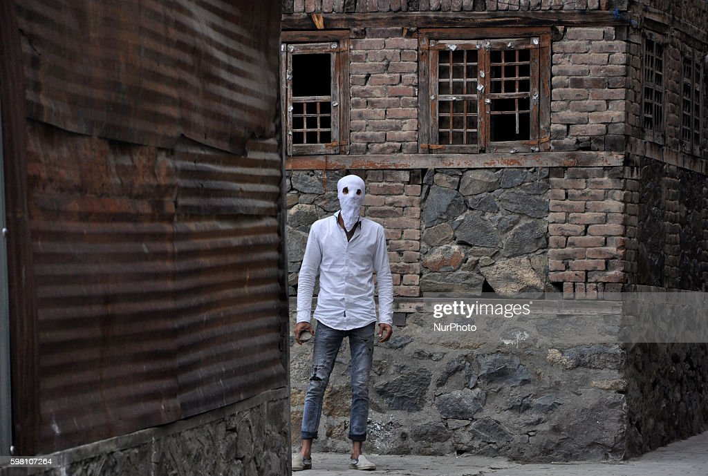 A kashmiri Muslim Protester Holding a stone Stands Inside an Alley during clashes in Old city Srinagar on August 31 2016 Protests erupted in Kashmir...