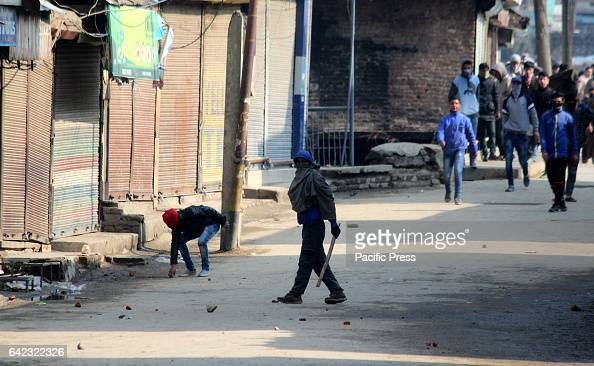Kashmiri Muslim protester holds a bamboo stick during clashes Clashes erupted between government forces and youth after congressional Friday prayers...