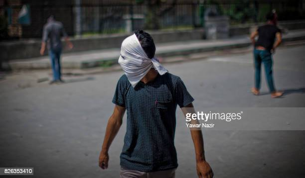 Kashmiri Muslim protester look towards his fellow protesters outside Kashmir's grand mosque during an antiIndia protest on August 04 2017 in Srinagar...