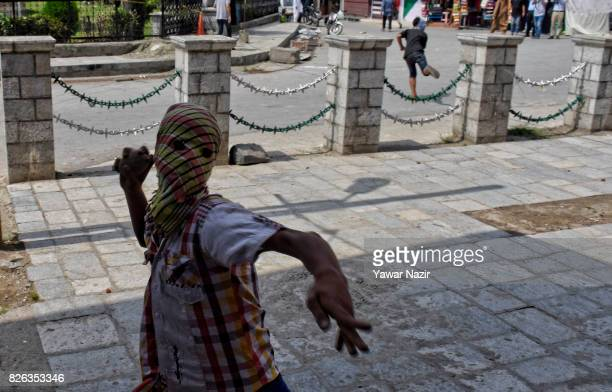 Kashmiri Muslim protester throw stones at Indian government forces outside Kashmir's grand mosque during an antiIndia protest on August 04 2017 in...