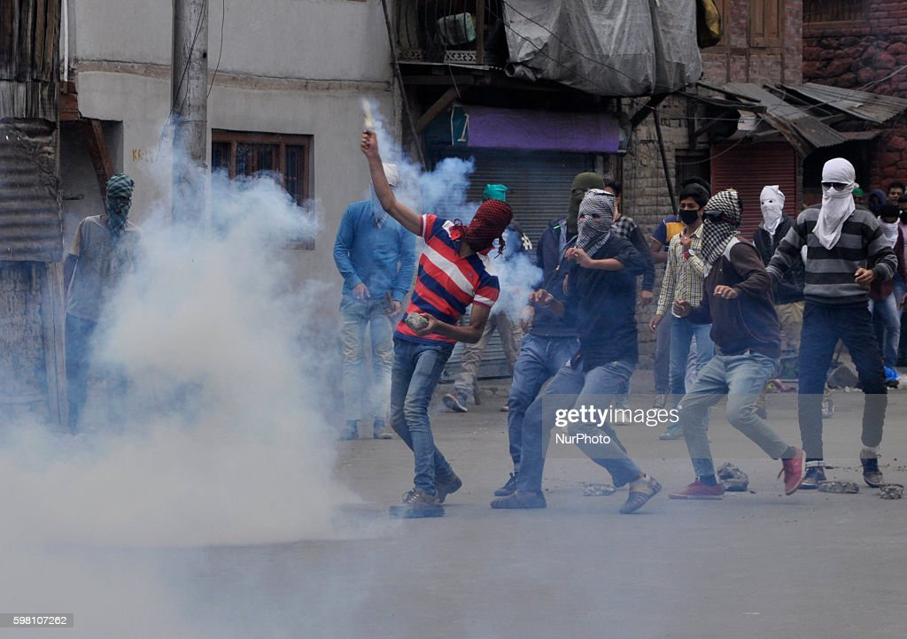 A kashmiri Muslim protester throws Back a Tear smoke shell during clashes in Old city Srinagar on August 31 2016 Protests erupted in Kashmir after...