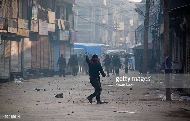 Kashmiri Muslim protester throws stones towards Indian government forces during an antielection protest on November 22 in Srinagar the summer capital...
