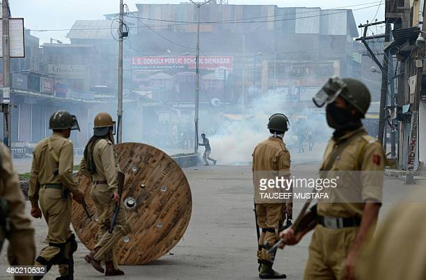 Kashmiri Muslim protesters clash with Indian police during a protest against Indian rule in Srinagar on July 10 2015 Police fired tear smoke shells...