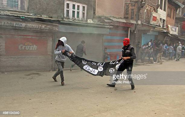 Kashmiri Muslim protesters display ISIS flag during profreedom demonstrations in old Srinagar the summer capital of Indian controlled Kashmir Angry...