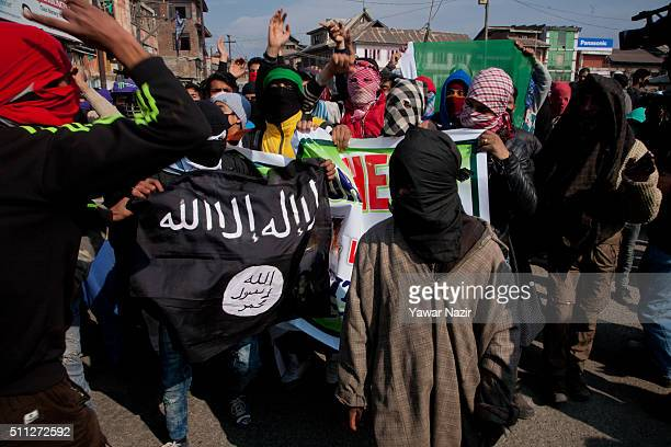 Kashmiri Muslim protesters hold an ISIS flag during an anti India protest on February 19 2016 in Srinagar the summer capital of Indian administered...