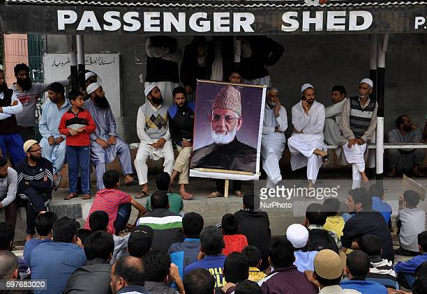 Kashmiri Muslim protesters Holding A potrait of Kashmiri separatist Syed ALi shah Geelani sit during a protest in srinagar on August 29 2016Indian...