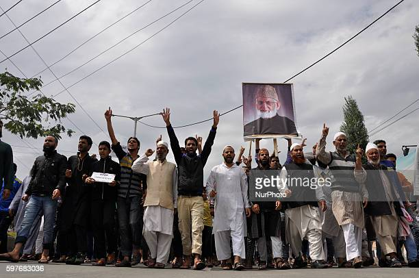 Kashmiri Muslim protesters Holding A potrait of Kashmiri separatist Syed ALi shah Geelani shout profreedom slogans during a protest in srinagar on...