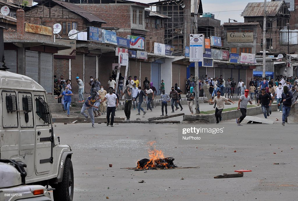 Kashmiri Muslim protesters Holding stones in hands Run to chase an Indian police vehicle during clashes in Old city Srinagar on August 31 2016...