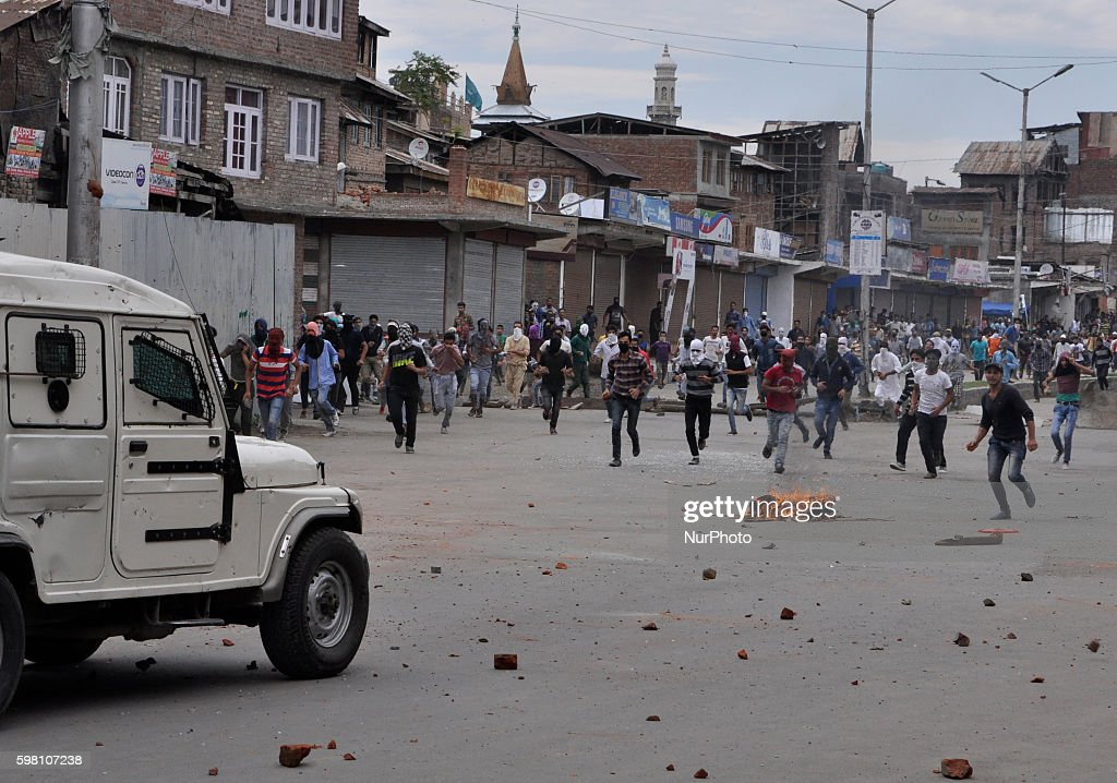 Kashmiri Muslim protesters Holding stones in the hands Run to chase an Indian police vehicle during clashes in Old city Srinagar on August 31 2016...