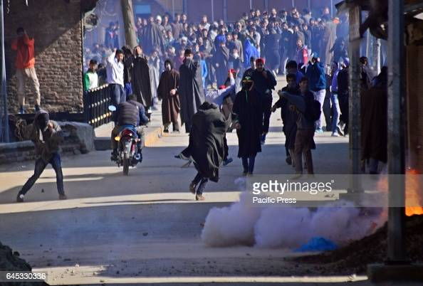 Kashmiri Muslim protesters running for cover after police hurled a sound grenade towards the angry protesters during a protest in sopore some 55...