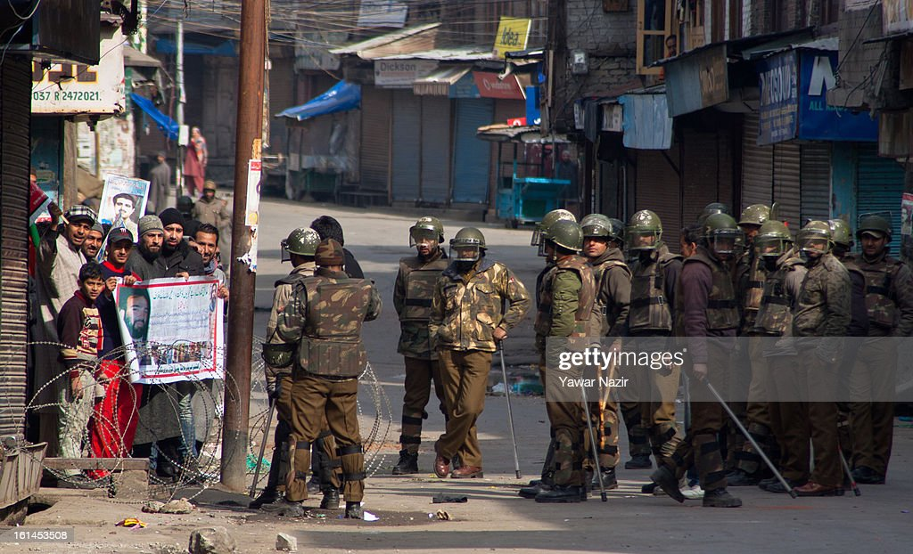 Kashmiri Muslim protesters shout slogans after they defied the curfew, imposed after the execution of alleged Indian parliament attacker Mohammad Afzal Guru on February 11, 2013 in Srinagar, the summer capital of Indian Administered Kashmir, India. Afzal Guru, from Sopore town in the north of Kashmir, was hung on February 09 for his role in the 2001 Indian parliament attack which left 14 dead. The hanging has further strained relations between India - who blamed the attack on 'Pakistan backed' militant group Jaish-e-Mohammed - and neighbouring Pakistan and has seen an military increase from both along the border.