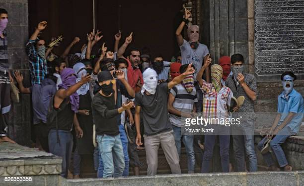 Kashmiri Muslim protesters taunt Indian government forces as they shout anti Indian slogans inside Kashmir's grand mosque during an antiIndia protest...