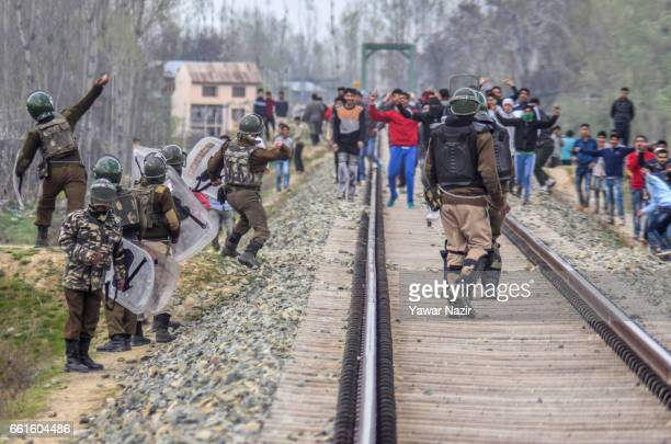 Kashmiri Muslim protesters throw stones at Indian government forces during an anti India protest against the recent civilian killings by Indian...