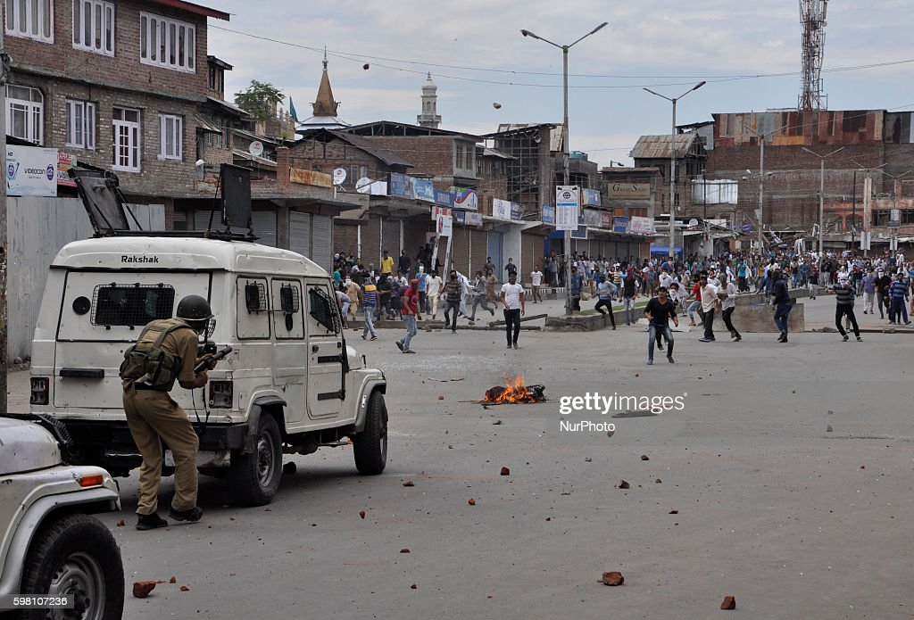 Kashmiri Muslim protesters throw stones towards indian policeman during clashes in Old city Srinagar on August 31 2016 Protests erupted in Kashmir...