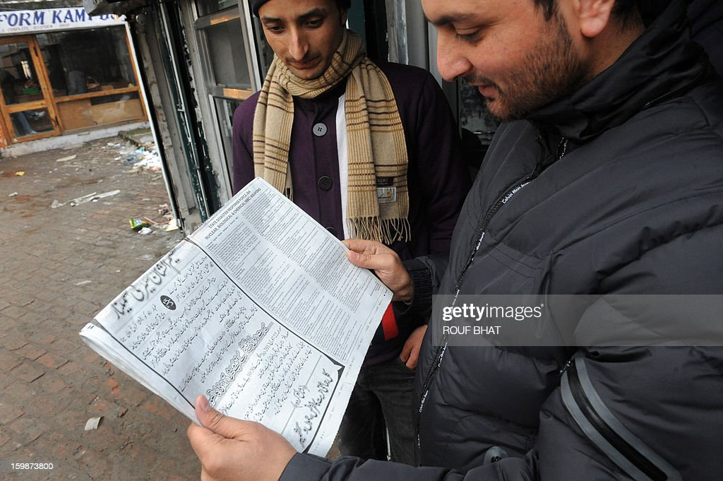 A Kashmiri Muslim reads a notice with instructions concerning a response to nuclear weapons issued by the police in the previous day's newspaper in Srinagar on January 22, 2013. Police in Indian Kashmir have warned residents to build underground bunkers to prepare for a possible nuclear war in the disputed region which is on edge after a string of deadly border clashes. The warning comes despite a ceasefire which took hold last week in the scenic Himalayan region after the Indian and Pakistani armies agreed to halt deadly cross-border firing that had threatened to unravel a fragile peace process. AFP PHOTO/Rouf BHAT