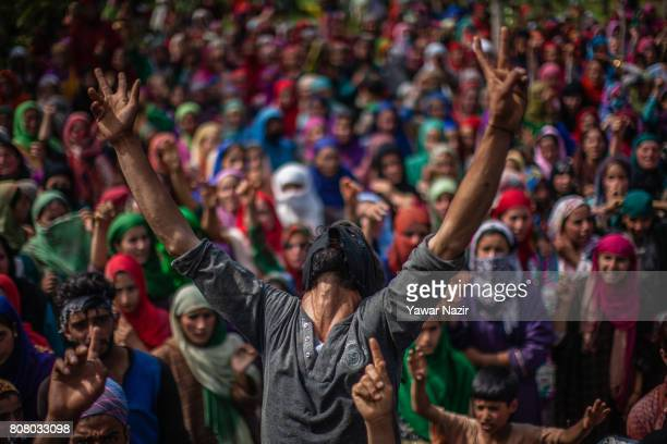 Kashmiri Muslim shouts anti Indian and pro Kashmir freedom slogans as he attends the funeral of Jahangir Khanday a Kashmiri rebel killed in a gun...
