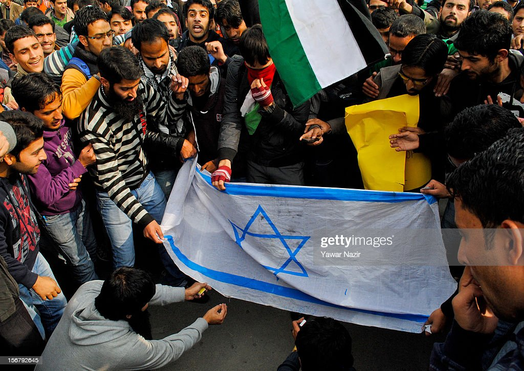 Kashmiri Muslim students of Kashmir University burn an Israeli flag during a protest against Israel and in solidarity with Gaza at Kashmir University campus on November 21, 2012 in Srinagar, the summer capital of Indian administered Kashmir, India. Hundreds of students of Kashmir University assembled in their University campus with placards and banners to protest against the recent Israeli strikes on Gaza.