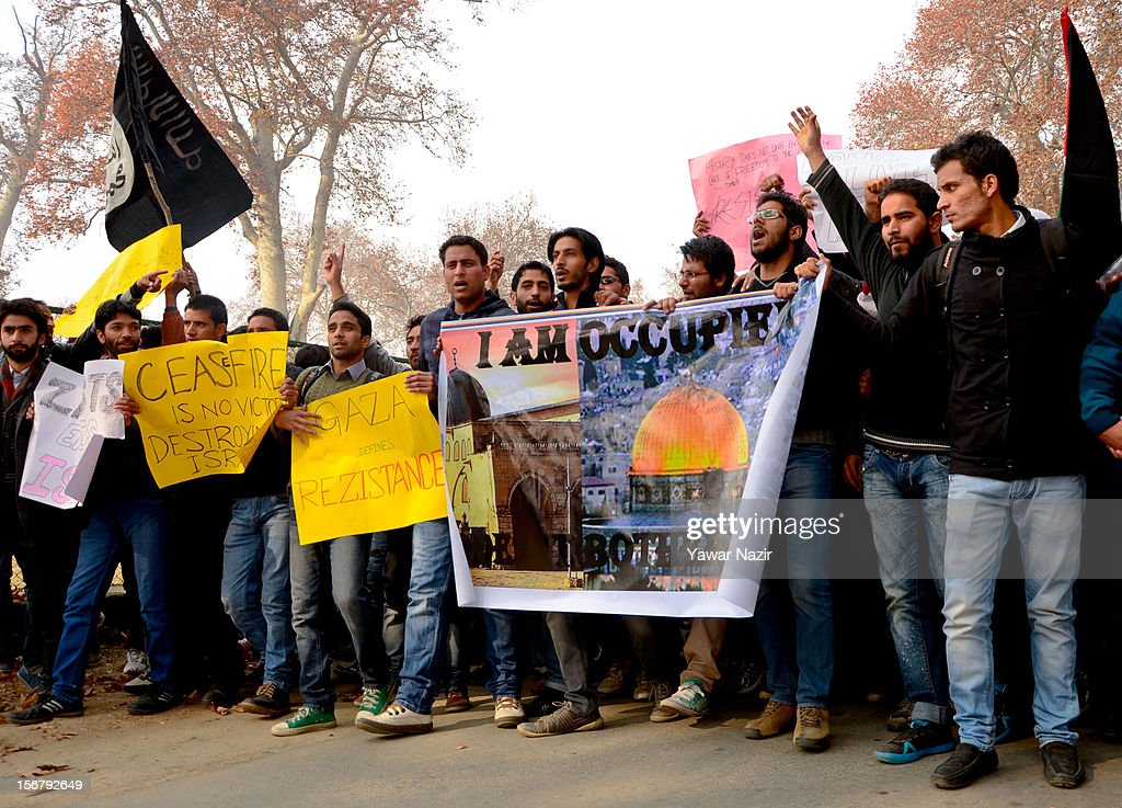 Kashmiri Muslim students of Kashmir University hold placards and banners as they shout anti-Israeli slogans during a protest against Israel and in solidarity with Gaza at Kashmir University campus on November 21, 2012 in Srinagar, the summer capital of Indian administered Kashmir, India. Hundreds of students of Kashmir University assembled in their University campus with placards and banners to protest against the recent Israeli strikes on Gaza.