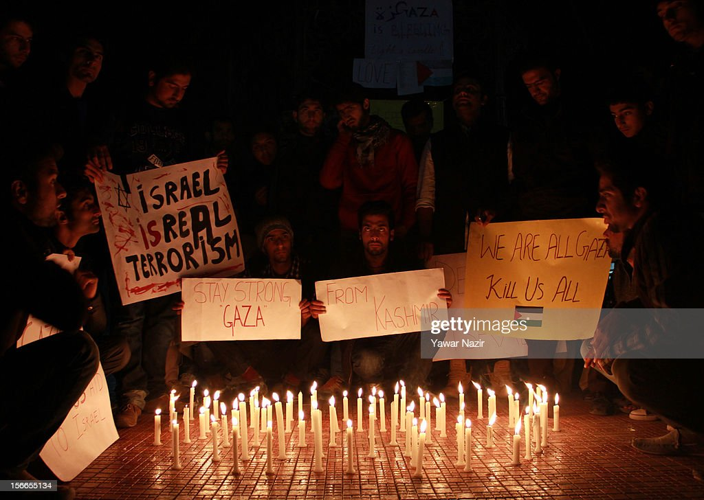 Kashmiri Muslim students of Kashmir University hold placards during a candle light protest against the Israel and US governments and in solidarity with Gaza at city centre on November 18, 2012 in Srinagar, the summer capital of Indian administered Kashmir, India. Dozens of students of Kashmir University assembled with placards and candle to protest against the recent Israeli strikes on Gaza.