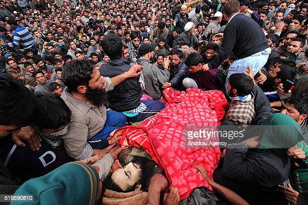 Kashmiri muslim villagers carry the body of district commander of Hizbul Mujahideen Waseem Malla in Pehlipora south of Srinagar the summer capital of...