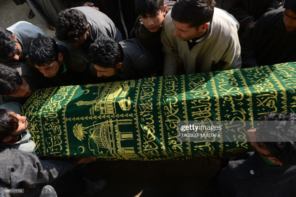 Kashmiri Muslim villagers carry the coffin of ruling National Conference sarpanch, Ghulam Mohammed Lone (45) during the funeral in Kulpora village of south Kashmir's Pulwama district, some 45 kms from Srinagar on April 9,2013. Unidentified gunmen shot dead the ruling National Conference sarpanch outside his residence. Militants have targeted several panchayat - local self-government - members, killing six of them in the Valley since the panchayat elections were held in April 2011. AFP PHOTO/Tauseef MUSTAFA