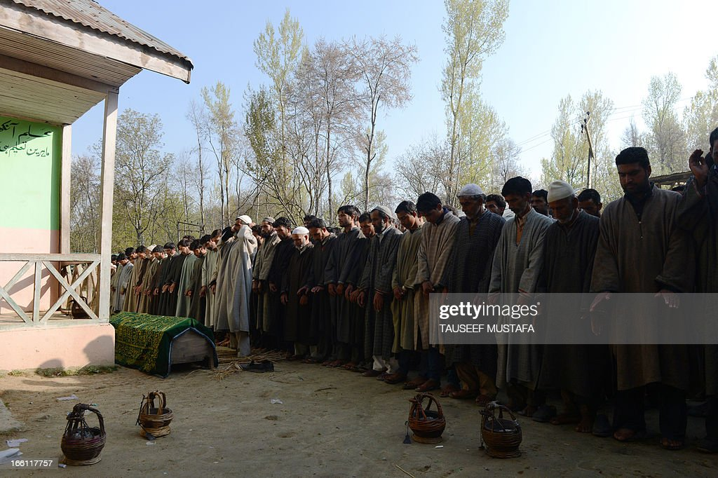 Kashmiri Muslim villagers offer prayers during the funeral of ruling National Conference sarpanch, Ghulam Mohammed Lone (45) in Kulpora village of south Kashmir's Pulwama district, some 45 kms from Srinagar on April 9,2013. Unidentified gunmen shot dead the ruling National Conference sarpanch outside his residence. Militants have targeted several panchayat - local self-government - members, killing six of them in the Valley since the panchayat elections were held in April 2011. AFP PHOTO/Tauseef MUSTAFA