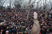 Kashmiri Muslim wait for the body of Arshid Ahmad one of two Kashmir militants killed in a gun battle with Indian government forces to arrive in the...