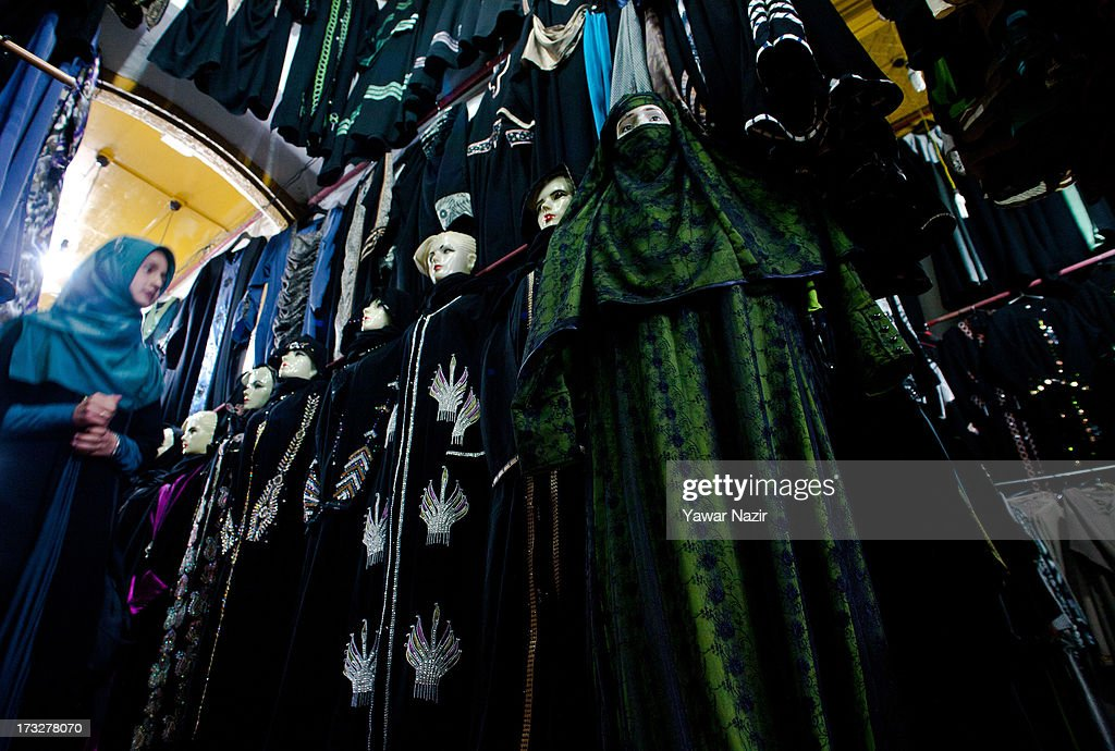 A Kashmiri Muslim woman chooses an abaya, a long tunic and veil, the standard ladies' fashion to wear, even in the presence of close male family members, in a store on the first day of Ramadan on July 11, 2013 in Srinagar, the summer capital of Indian administered Kashmir, India. Ramadan is the ninth month of the Islamic lunar calendar, during which Muslims believe the Quran was given to Prophet Muhammad. Muslims across the globe abstain from eating, smoking, and sex from dawn to dusk during the month. Besides spending more time praying, donating alms is mandatory. Every Muslim has to give 2.5 percent of their wealth and assets to the poor, and often give more.