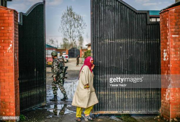 Kashmiri Muslim woman comes out of polling station after casting her vote during the elections of the lower house of Indian parliament on April 09 in...