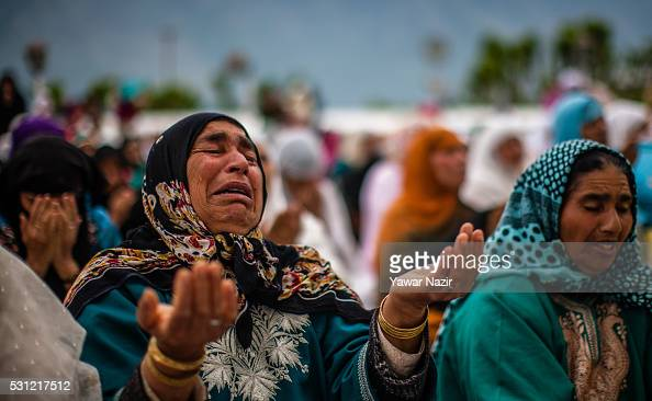 Kashmiri Muslim woman cries as she prays at the Hazratbal Shrine on the Friday following MehrajuAlam which marks ascension day the journey from earth...