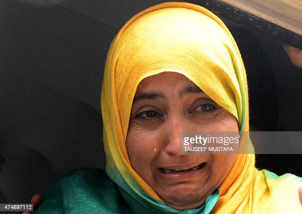 A Kashmiri Muslim woman cries next to a body of a youth at a hospital in Srinagar who was killed in an attack by suspected militants on May 25 2015...