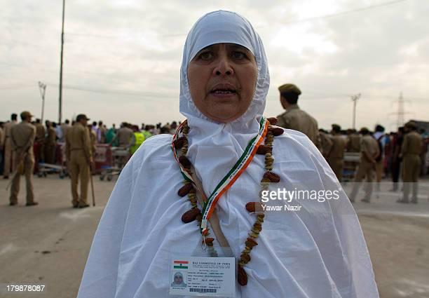 Kashmiri Muslim woman Hajj wearing garland of dates raisin and cadmium as she departs for the annual Hajj pilgrimage on September 07 2013 in...
