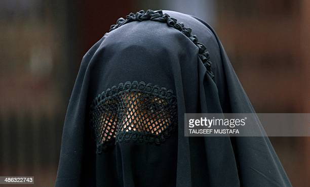 A Kashmiri Muslim woman looks on after casting her ballot at a polling station in Bijbehara some 42kms south of Srinagar on April 24 2014 Indian...