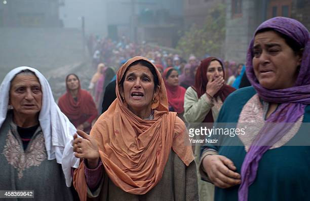 Kashmiri Muslim woman mourn over the killings of two civilians Faisal Yousuf and MehrajudDin Dar by Indian army during their funeral on November 04...