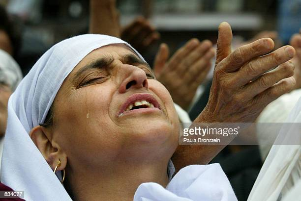 Kashmiri Muslim woman prays as relicts of the Sufi Saint Hazrat Gousul Azam Dastageer are displayed to the public rejoicing his birthday at the...
