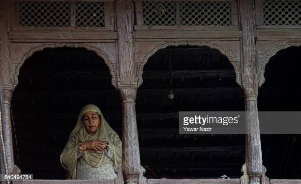 Kashmiri Muslim woman prays at the shrine of Khaniqahi mullah during a festival on August 29 2017 in Srinagar the summer capital of Indian...