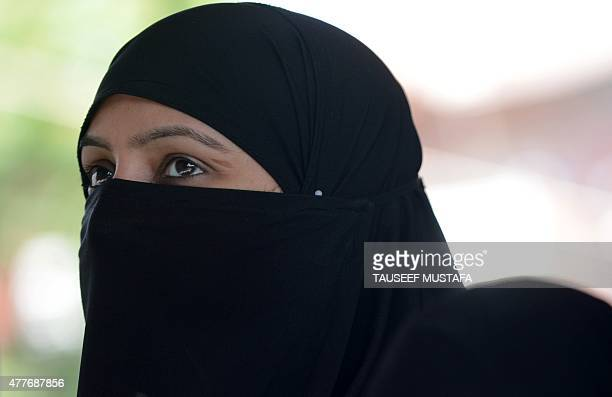 A Kashmiri Muslim woman prays during the first day of the month of Ramadan at the ShahiHamdaan shrine in Srinagar on June 19 2015 Across the Muslim...